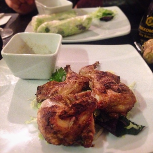 Chargrilled quail with lemongrass (front) and pork belly summer rolls (back.)